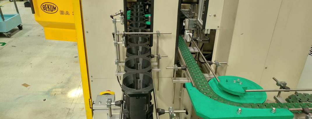 3D printed toner bottle pucks in use on production line